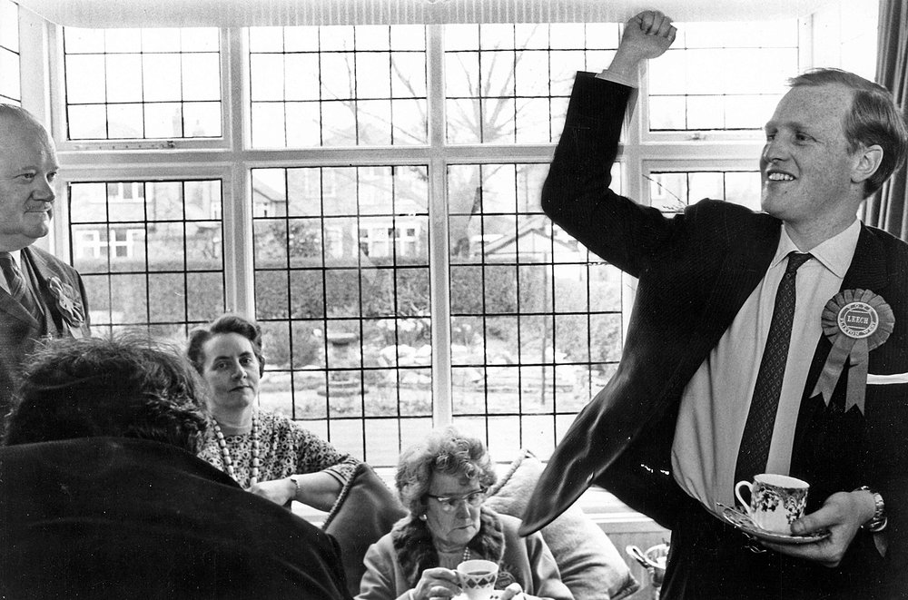 Tea and, possibly, crumpets as Winston Junior celebrates suburban conservatism during a local election in Flixton West, south Manchester in the early 1970s (image Don Morley)