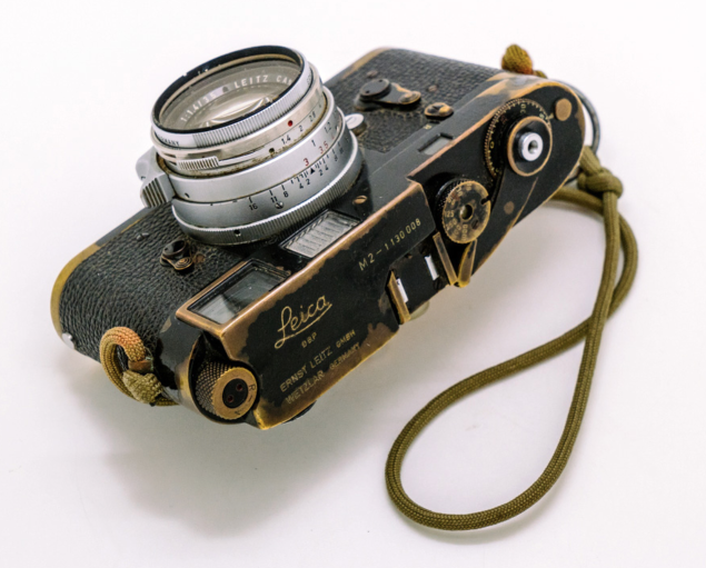 "Sean Flynn's M2 with its 35mm Summilux. The strap was hand fashioned from a parachute cord and a hand grenade pin during a war photographer's ""craft session"" in Vietnam. (Image Bellamy Hunt)"