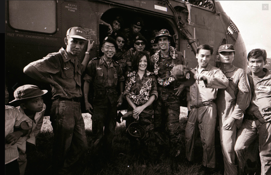 Sean Flynn, centre right, during the Vietnam war