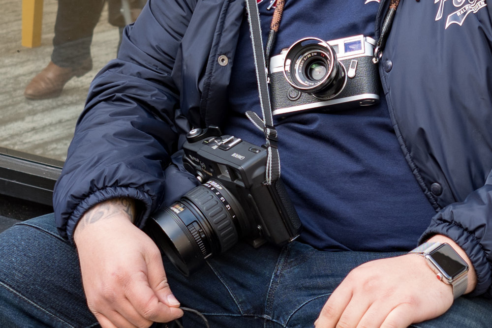 Not only does Nico carry his pristine Leica M7 with a well-used Zeiss Biogon 35mm, but for even more detail he hefts the Fuji 6x9in GW690 III. Incidentally, I approve of the Apple Watch Series 3. It provides a wonderful contrast to the old-school photography gear