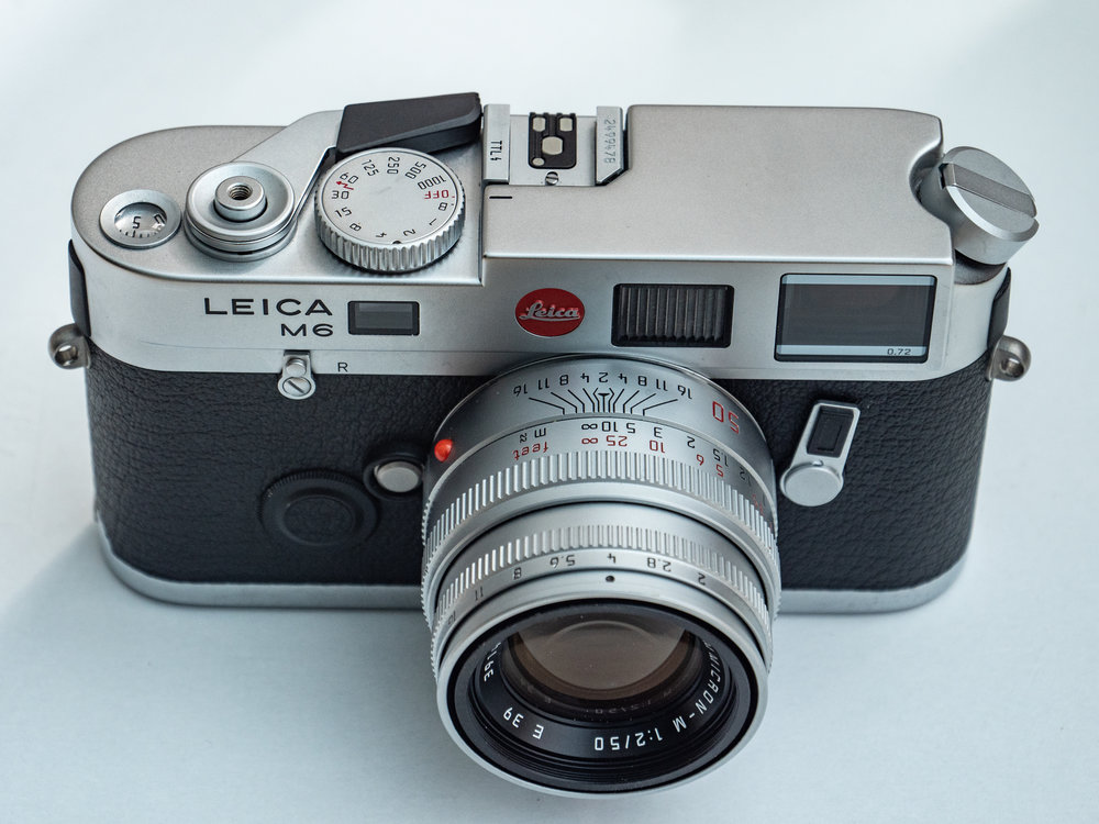 """The M6 TTL is an enhanced version of the """"classic"""" M6 with improved flash metering and the larger shutter speed dial which moves in the opposite direction as a more natural complement to the exposure indicator triangles in the viewfinder"""