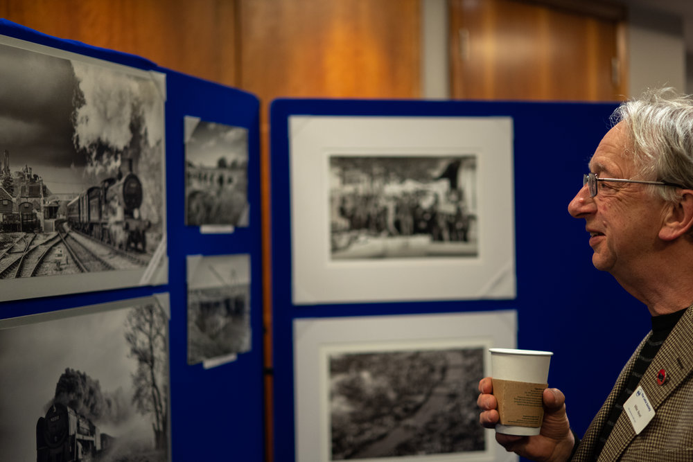 Mike Ravel admiring one of Keith Walker's iconic steam train prints in the weekend exhibition room (Image Leica CL and 35mm Summilux-TL)