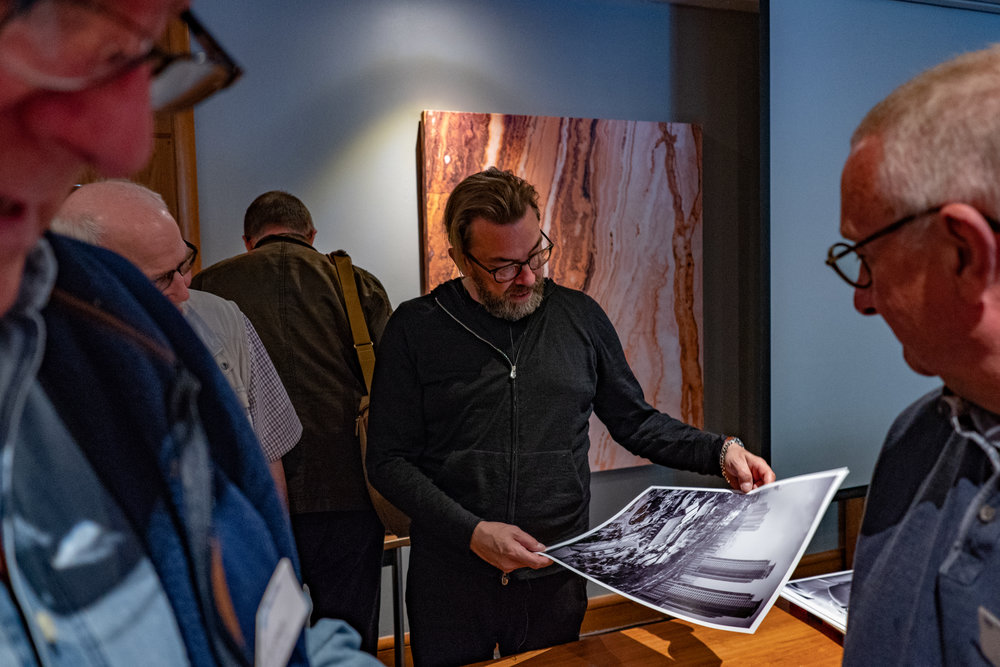 Thorsten and his prints, surrounded by TLS members including Peter Cheetham, Tom Lane and John Dodkins in the background (Image Leica CL and 35mm Summilux-TL)