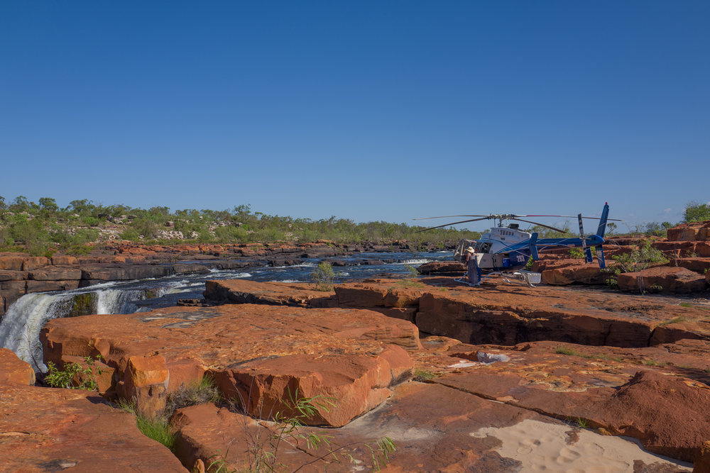 Landing by helicopter on top of the King George Falls
