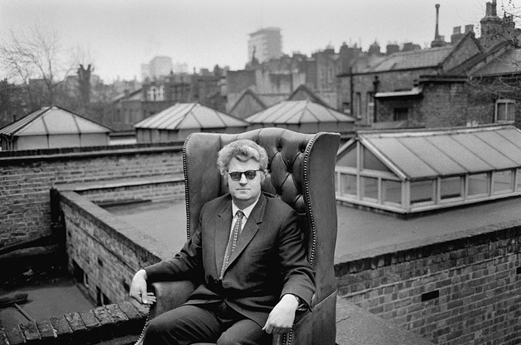 Colin Osman, photographer and grandson of the magazine's founder. A.H.Osman, sitting rather incongruously in a leather wing chair on the roof of 19 Doughty Street. The birds would have been cooing nearby, without a doubt (photograph  The Golden Fleece )