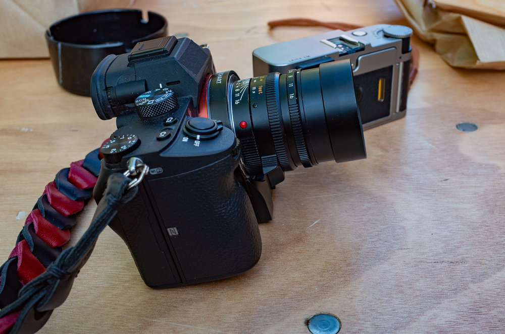 The Techart adapter has a small motor pod at the bottom. In the case of the a7III this protrudes. It isn't an inconvenience and acts as a stand to stop the lens tipping down onto a surface