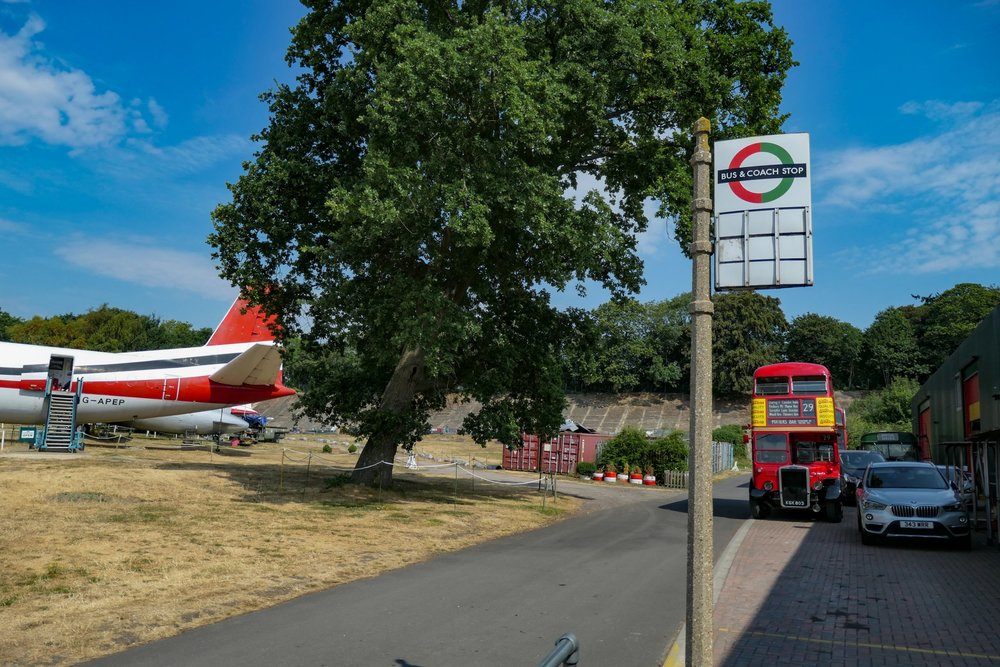 Planes, buses, bus stops and shipping containers   — a busy scene at 24mm. Below, two 360mm zoomed images taken from the same scene (not crops in this case)