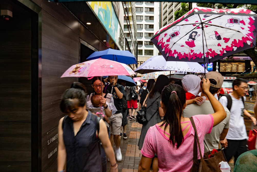 Umbrella jam: Hong Kongers are masters of driving umbrellas, but watch out for your eyes
