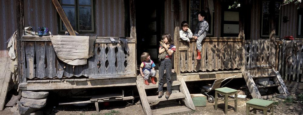 Children play on the veranda of their house in Danesti, Szekely region of Transylvania Romania. 2001. Hasselblad   Xpan and 45mm lens