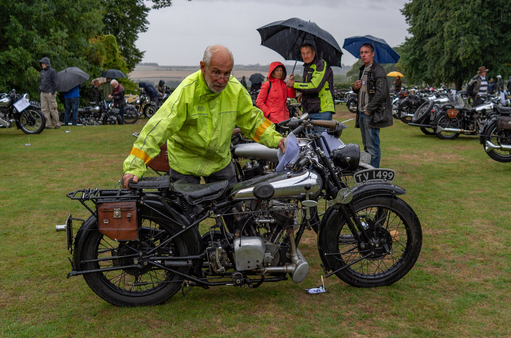 Soft grass surfaces and motorcycle parking are not congenial companions, as this Brough enthusiast is finding out. Incidentally, the plate tells me that this particular Brough was registered in Nottingham, home of the Brough factory, so it probably has a particularly interesting history