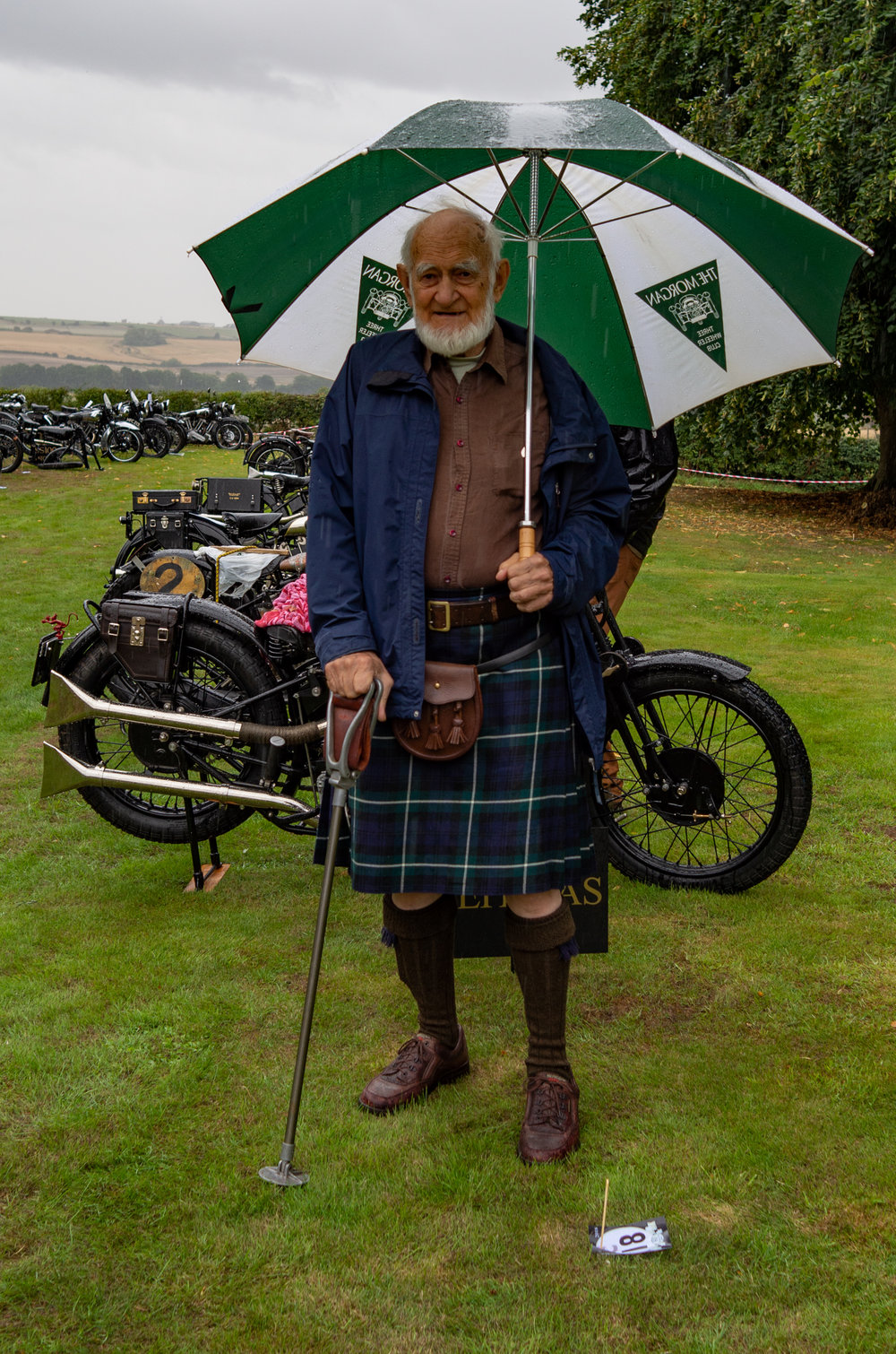 The kilt isn't the ideal gear for a rumbustious SS100, especially on such an ingloriously wet day. This impressive gentleman is the Reverend Michael Staines, one of the earliest members of the club in 1958