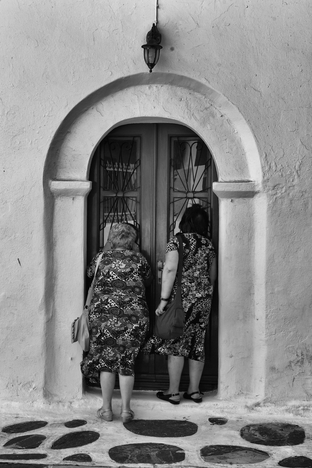 Ladies who peek... A scene from the Aegean island of Mykonos captured on the Mk.I Monochrom and processed, of course, in Apple's Aperture