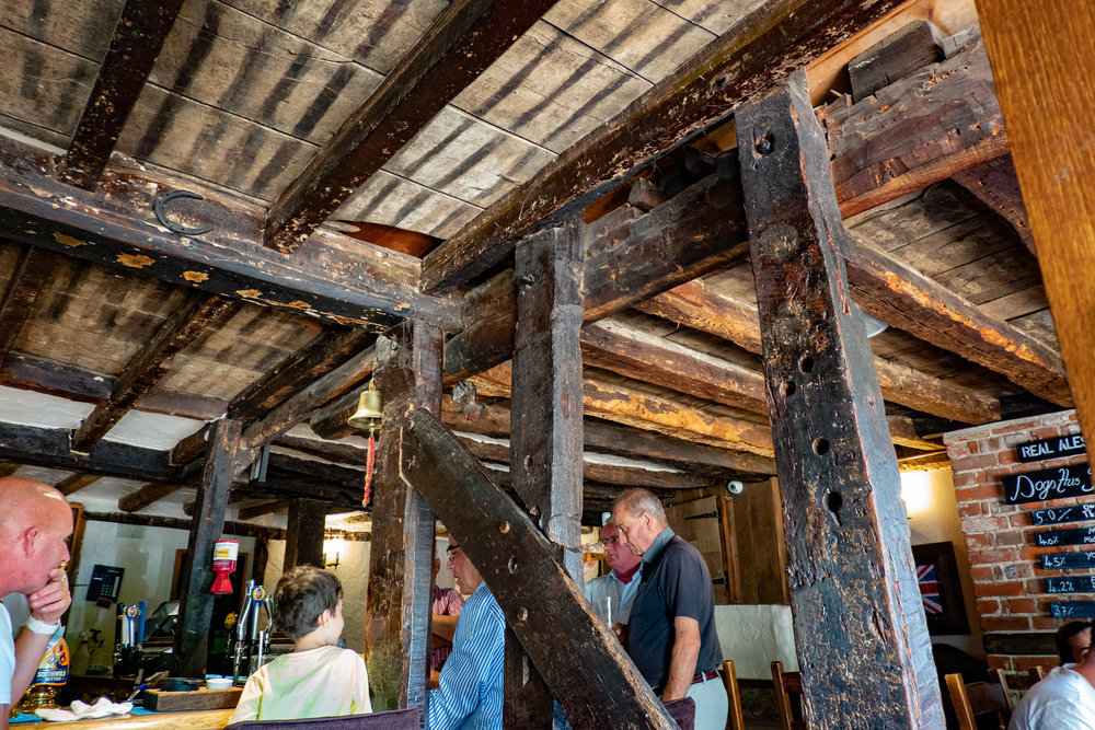 Ancient beams have seen many a pint pulled at the historic    Hoop at the village of Stock    in Essex. The interior shot is taken at ISO 800, 1/25s, f/2.8, 24mm