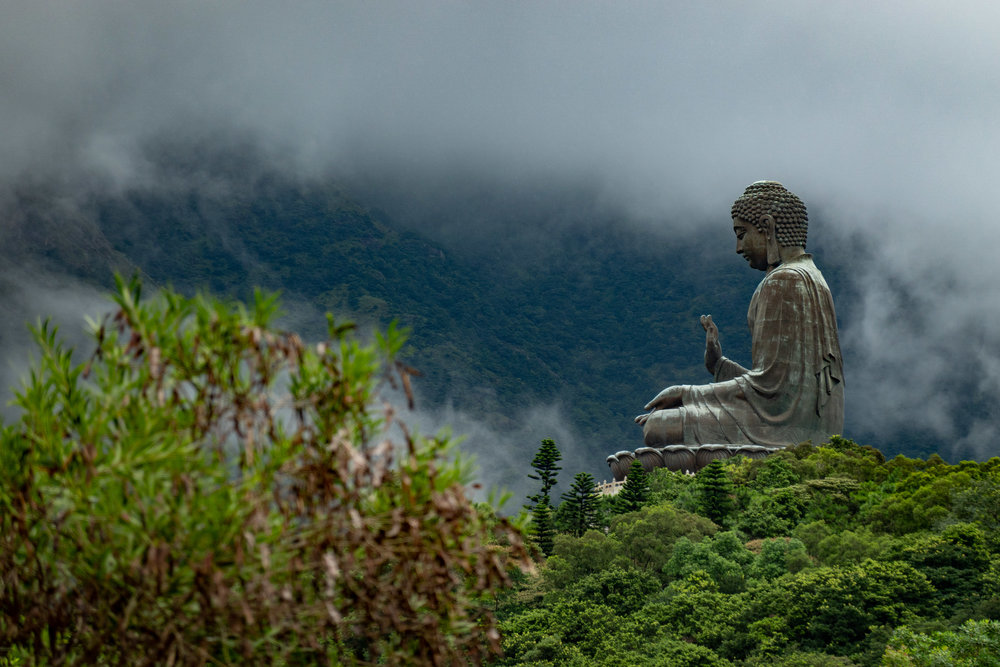 Above: One of my favourite images from Hong Kong  —  the Big Buddha on Lantau Island.. This was a quick snap as I emerged from the top station of the cable car, taken at 1/250s, f/4.5 and at the maximum zoom. Below is a crop with a x22 magnification, still with impressive detail. The second image is a wide-angle view from the same vantage point, giving a good impression of the distance involved. Click on these images to see full size.