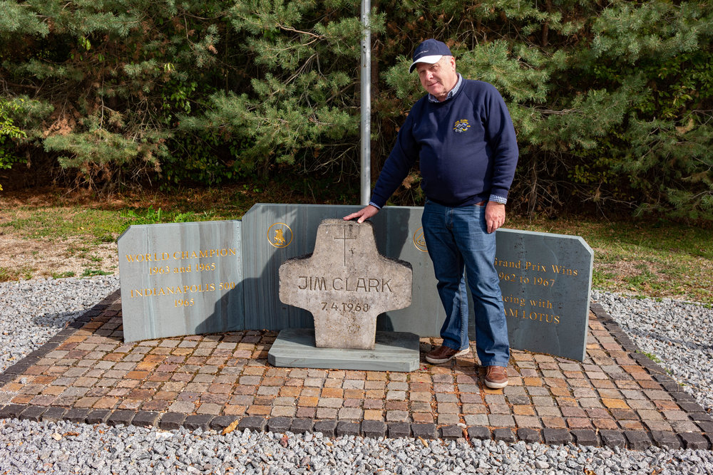 Jim Clark's most ardent fan, John, with the new memorial on the edge of the race circuit. The central cross was moved from the original scene of the accident when the circuit was shortened in 2002. Most visitors will now assume that this is the site of the fatal accident