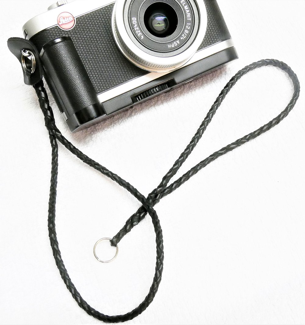 The first camera wrist strap, made from 3mm lacing and attached to the Leica X2, crafted by an expert. The unattached strap is my novice attempt. It will go on the Leica D-Lux.