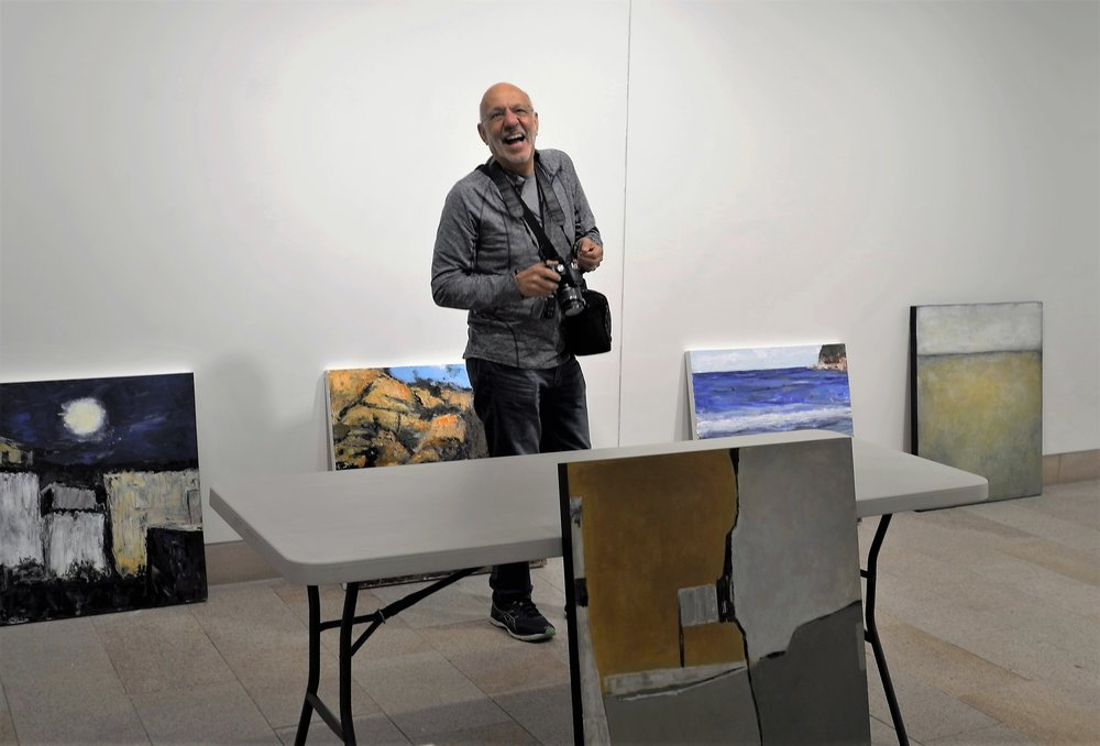 Friend Conway at an art exhibition hanging. He's a Nikon guy. That's fine. It makes him smile
