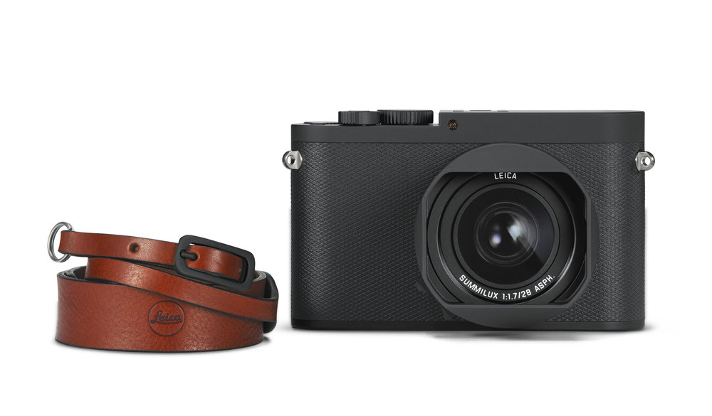 The Q-P comes with a very attractive leather strap and a spare battery