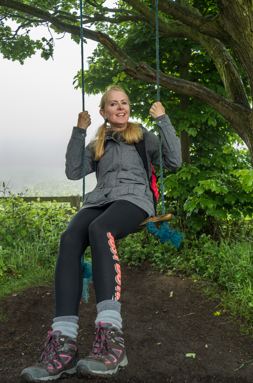 Liz messing around on a track side swing - Health and Safety eat your heart out.