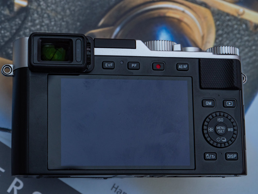 Business as usual at the back of the camera — clearly laid-out controls and a fixed screen, perfectly flush with the body. The small thumb grip is useful but doesn't compensate for the slippery front of the body