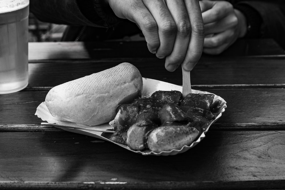 Currywurst mit Brötchen, a noted German delicacy: But isn't that sauce supposed to be red? Disappointment.