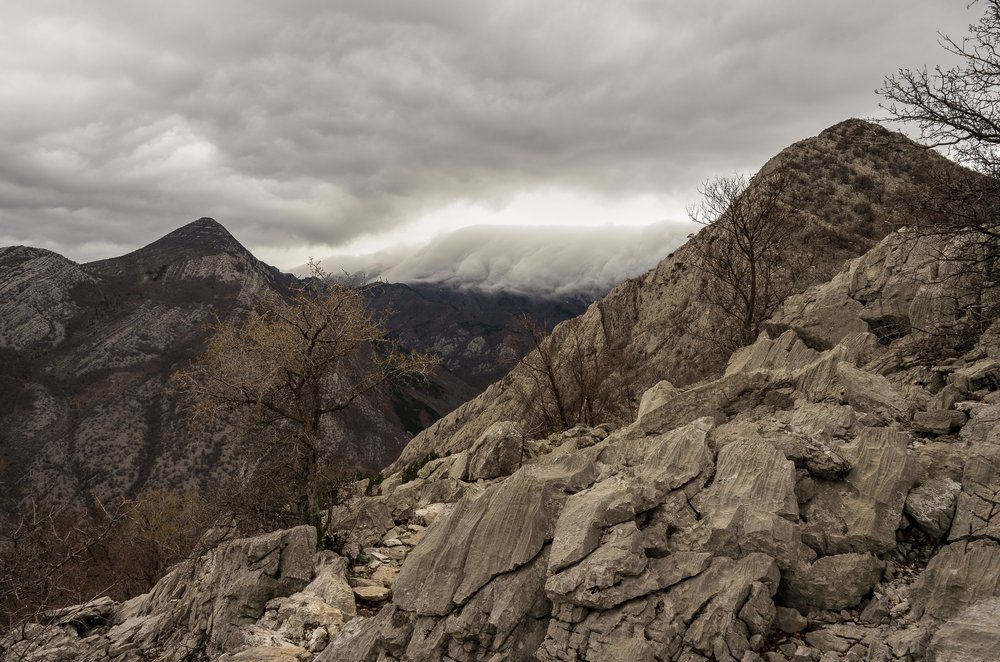 High up on the hills leaving the Grabove Doline area with storm clouds falling over the Velebit mountains.