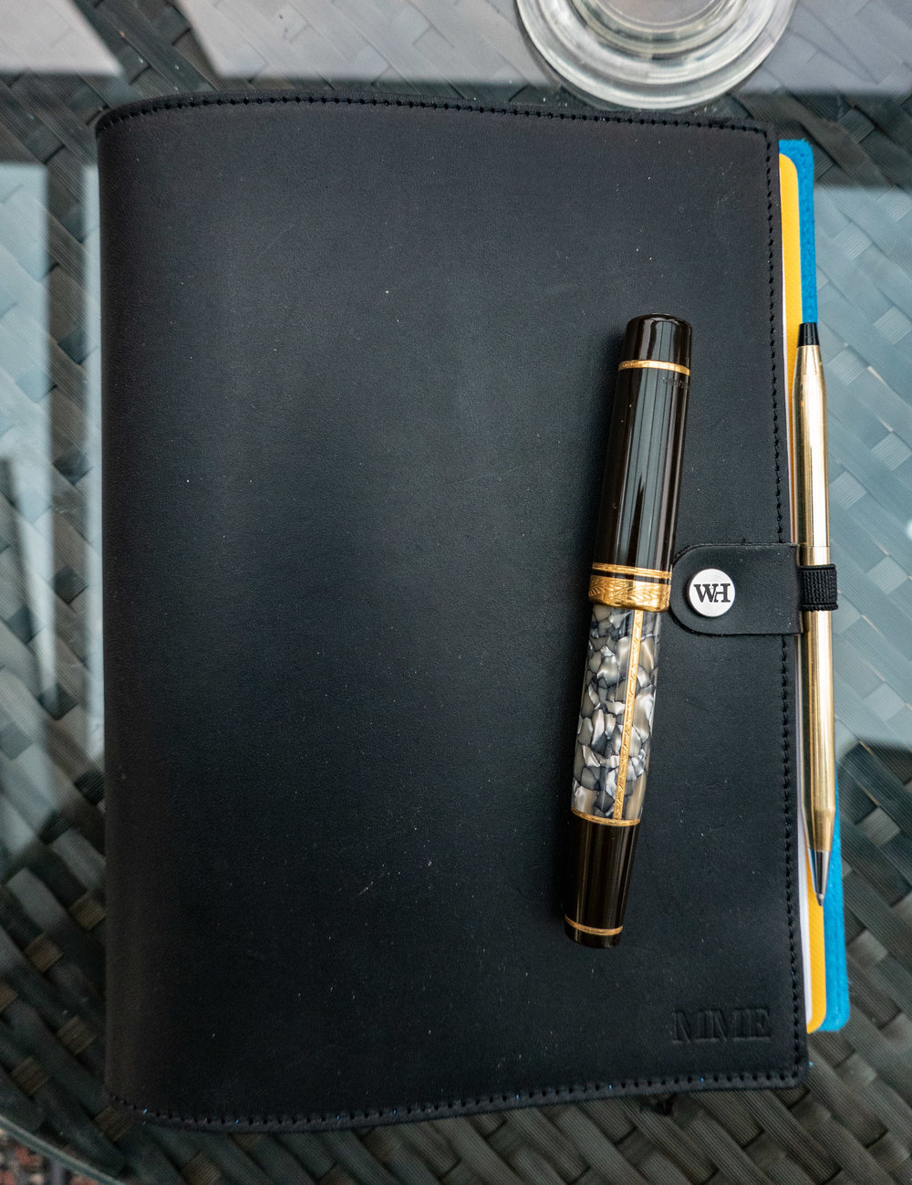 The William Hannah A5 notebook closed. The vintage Cross ballpoint pen fits the pen loop perfectly and is ideal for travelling. But for erious writing I prefer a fountain pen, such as the Montblanc. Note the monogram — a small extra charge when ordering your cover.