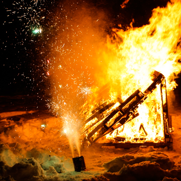 This is how we ring in the New Year in Alaska: soak a bunch of wood palettes in lighter fluid and shoot the damn thing with roman candles until it explodes. Oh, and this is all done on a frozen lake (photo courtesy of Michael Erving)