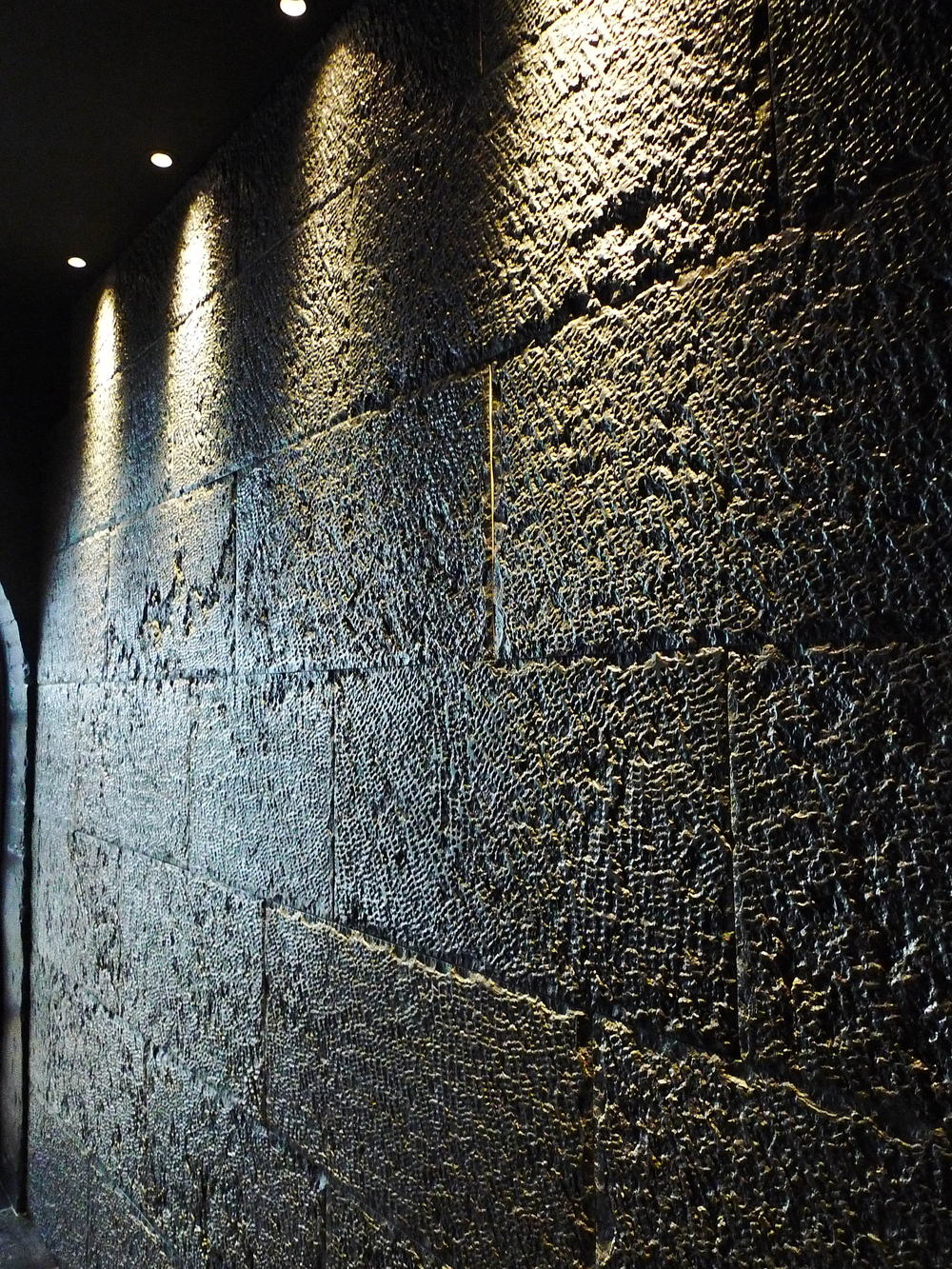 Wall grazing accomplished to stunning effect at the Lapicida showroom in London. Lighting design by Sally Storey.