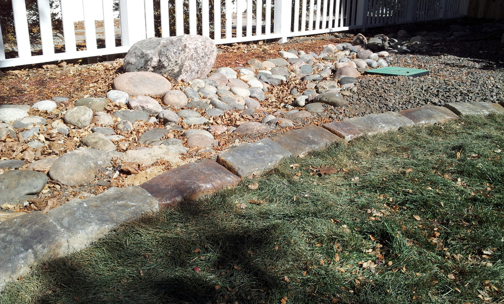 Realistic Stone Edging from Concrete Curbing.jpg