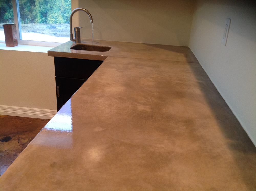 We installed this top for Diane and Ben's basement wet bar in Colorado Springs.  With an integral concrete sink and hand hewn tops the project came out awesome!