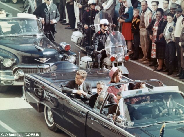 John and Jackie Kennedy riding through the streets of Dallas on November 22, 1963. He would be assassinated shortly after this photo was taken.