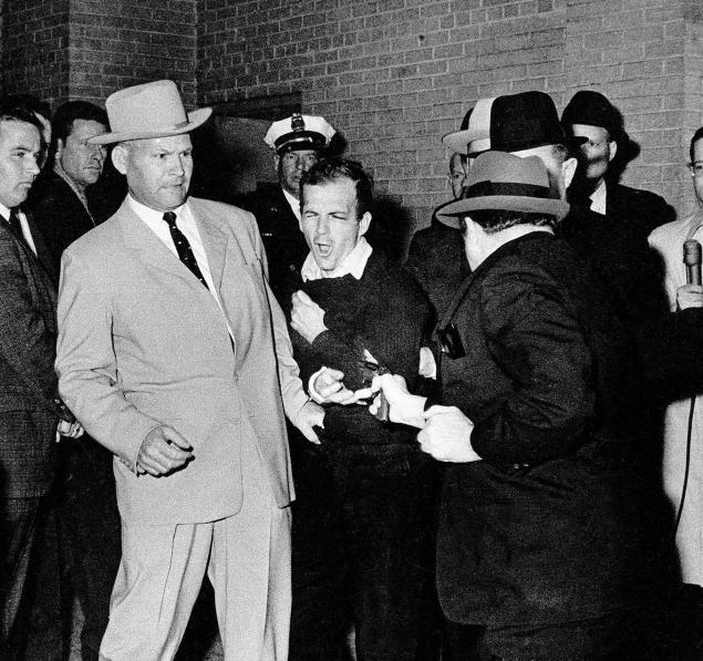 Jack Ruby shoots and kills Oswald as he is being transfered to the Dallas Country Jail from Dallas Police Headquarters.