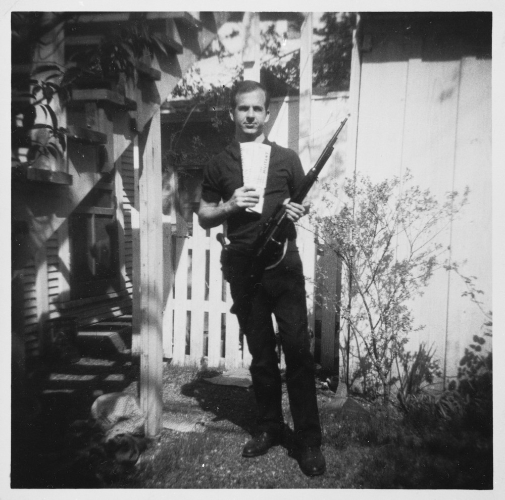 Picture taken by Marina Oswald of her husband holding the rifle he would later use to kill Kennedy.