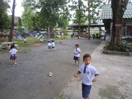 Young kids playing soccer.
