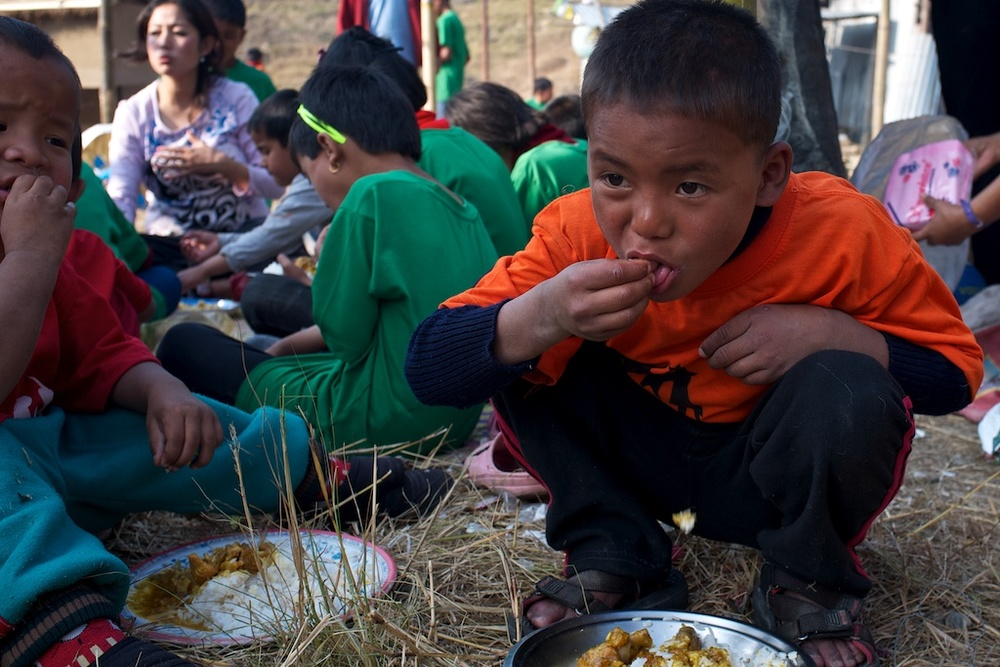 The Kalimpong 2 kids know how to put away the food.