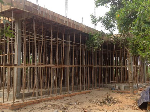 Bamboo is often used as scaffolding and support for construction projects in Cambodia.