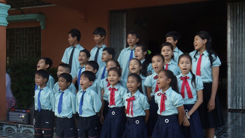 BB5 kids practicing a song before their Christmas Day performance.