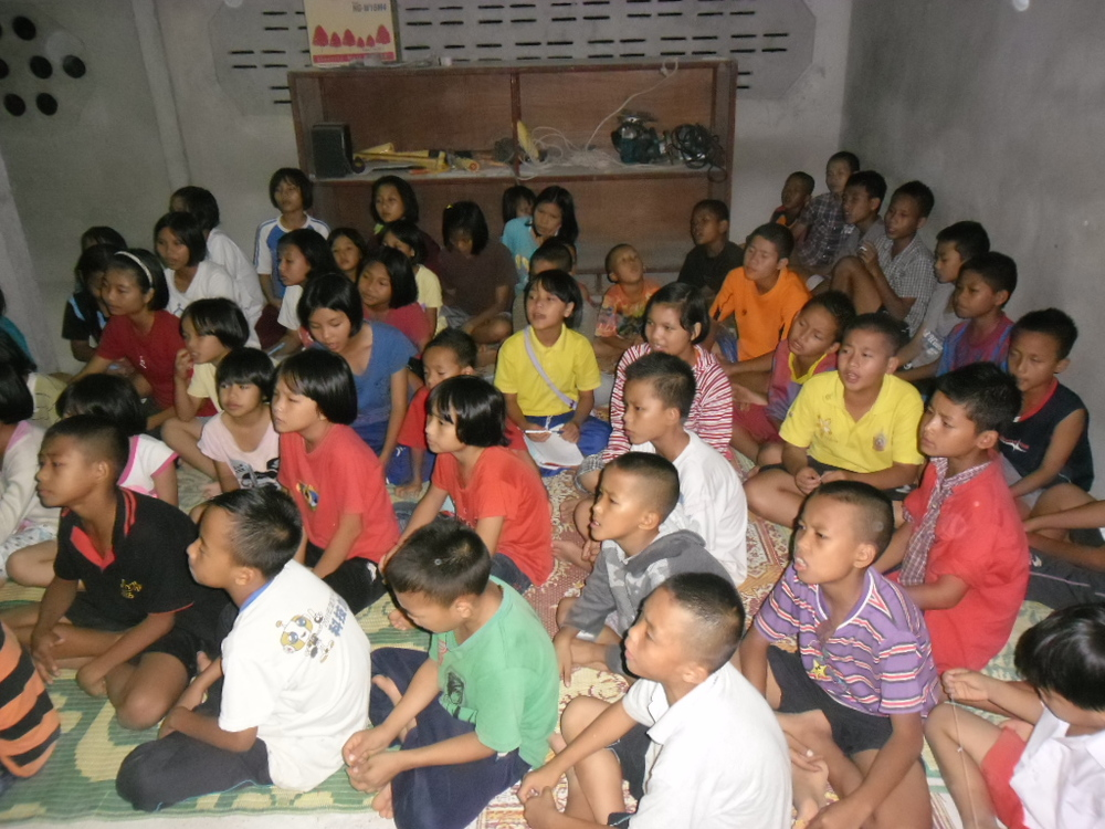 Kids sitting in church.