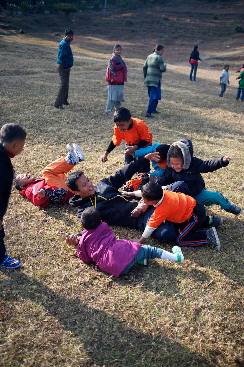 Our India Director Nandu playing with the children.