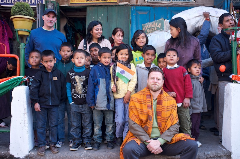 John McCollum and Tim and Carol Richardson with several of the KP2 children in Kalimpong.