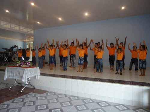 The BB6 kids performing a song at church.