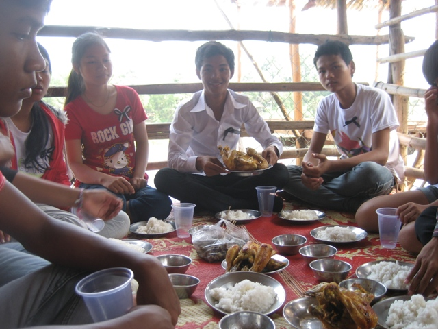 Some of the older kids enjoy a special meal by the river.