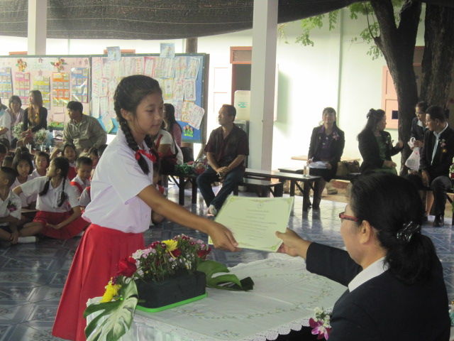 The kids from Doi Saket 1b receive their diplomas. We're proud of our graduating students!