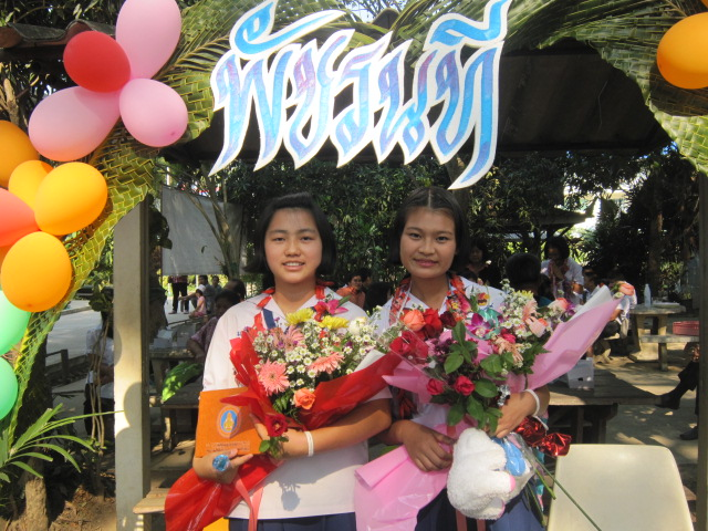 Middle School graduates with gifts and flowers.