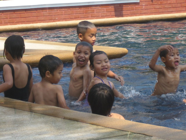 The little ones enjoy a day at a local pool.