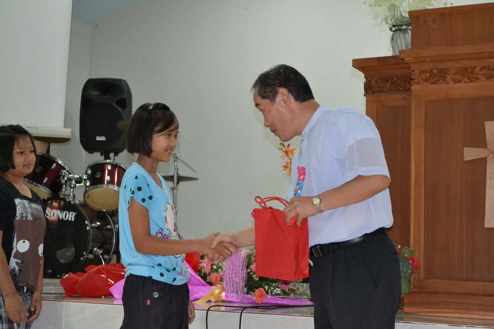 All of the kids receive special gifts on the occasion of their school promotion.