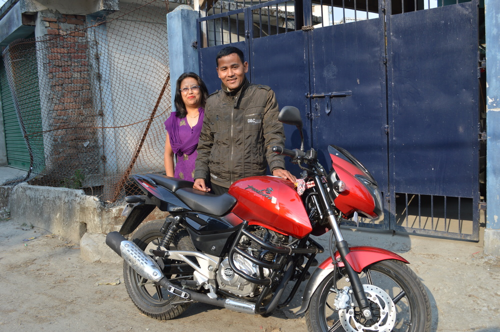 Sunil and Punam, Kalimpong 2 dad and mom, are thankful for the new motorcycle Asia's Hope was able to purchase for their use.