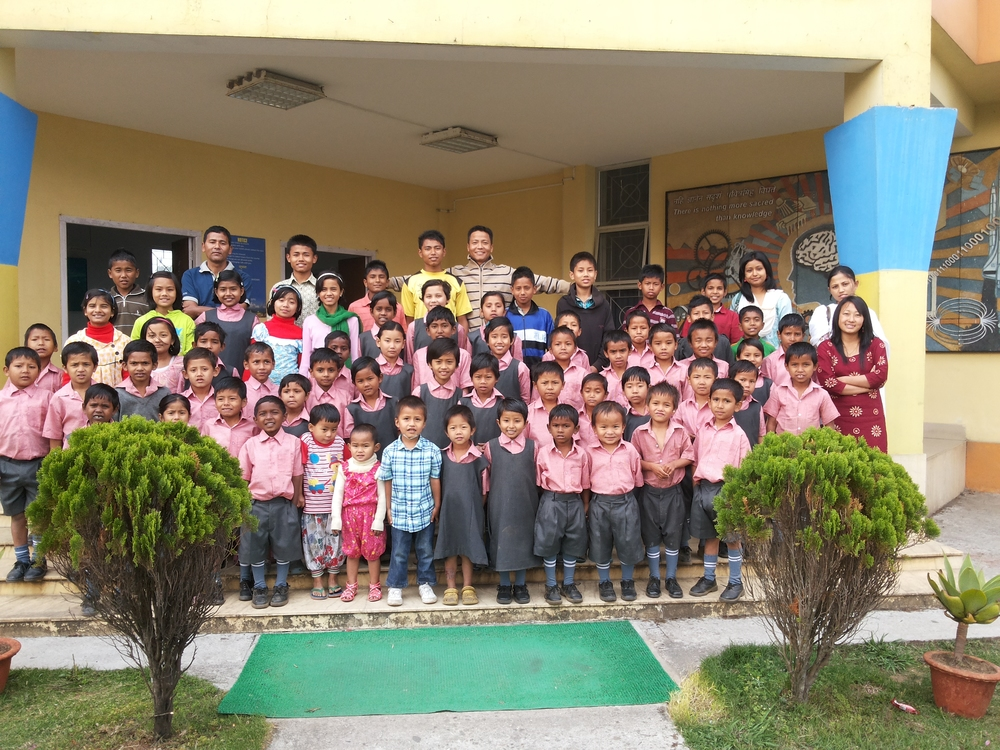 Some staff and kids from both Kalimpong homes pose together.