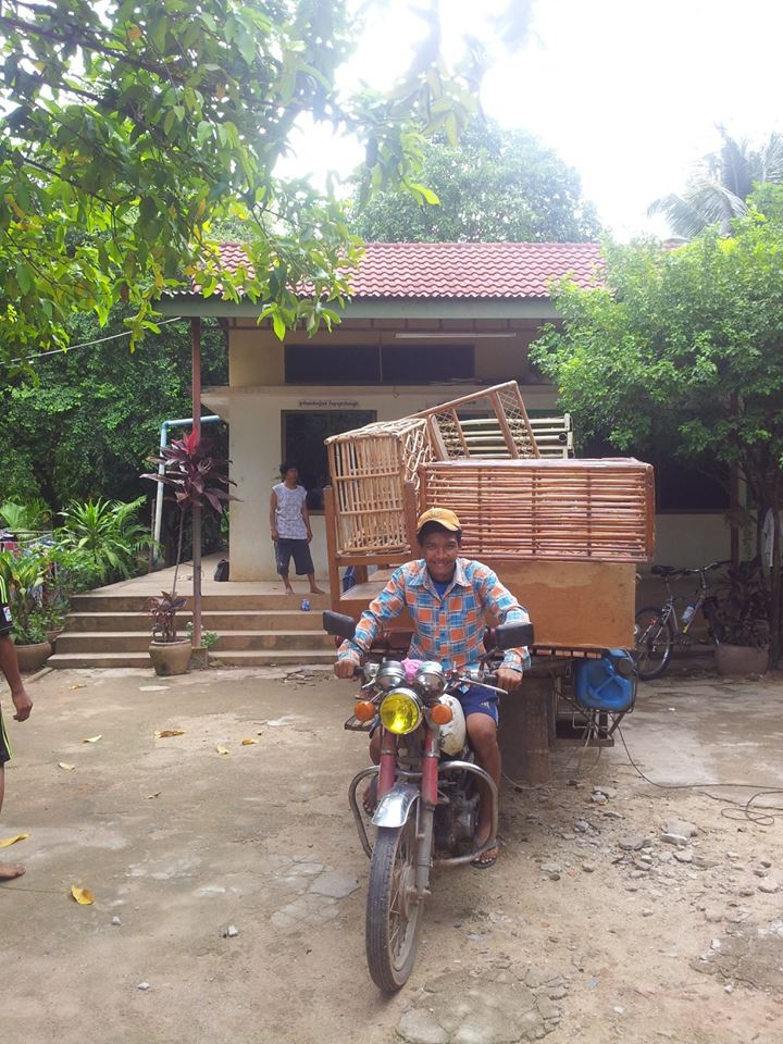 Vilaiy, one of the older boys from Prek Eng 2, packs up furniture from the old house to take to the new one!